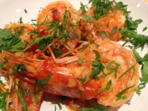 Spicy prawns with garlic, lemon zest, chilli and parsley